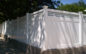 Vinyl Privacy Fencing Solid with Lattice on Block Wall